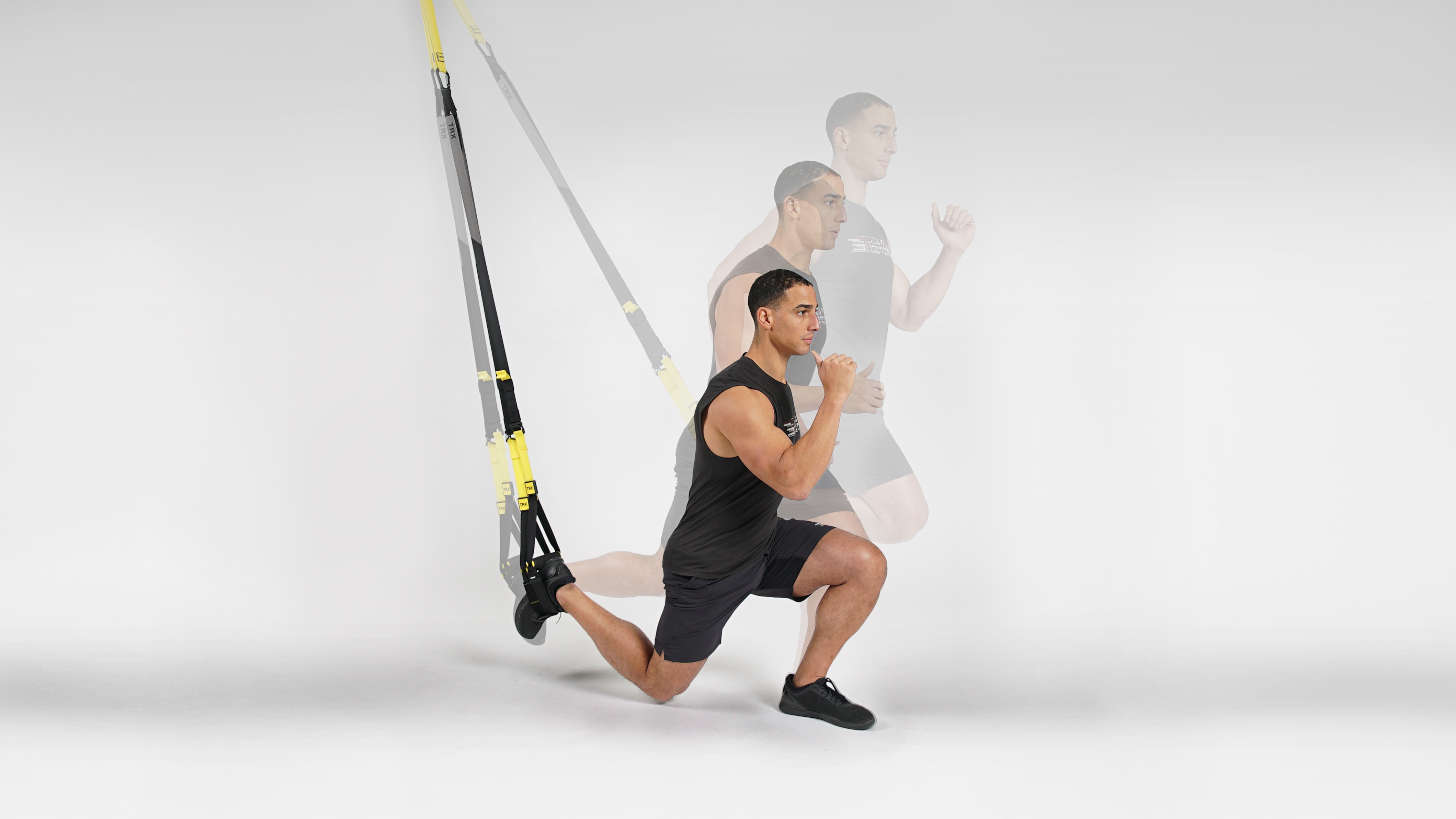 man performing a TRX lunge