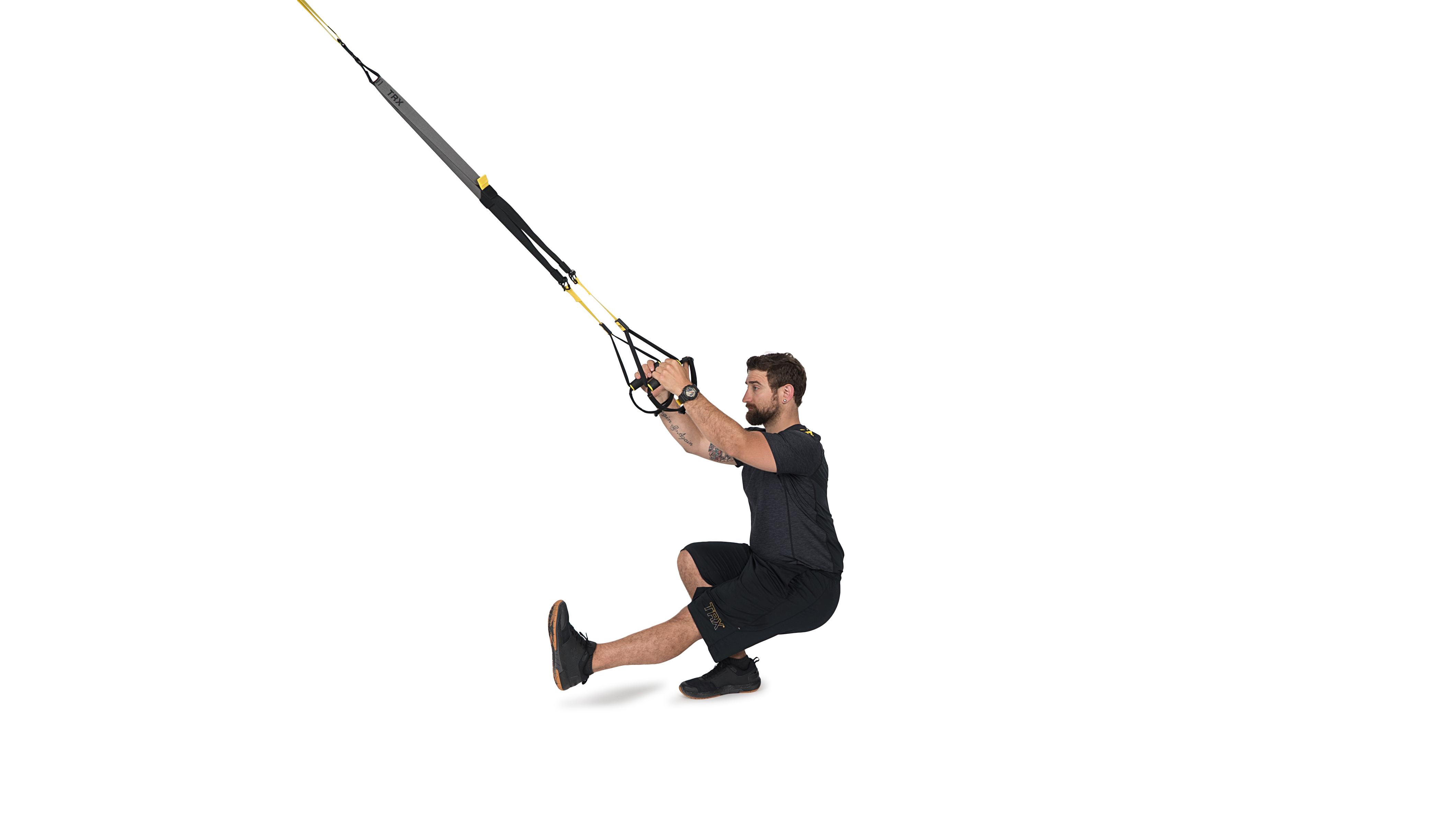 man performing a single leg squat on TRX Suspension Trainer