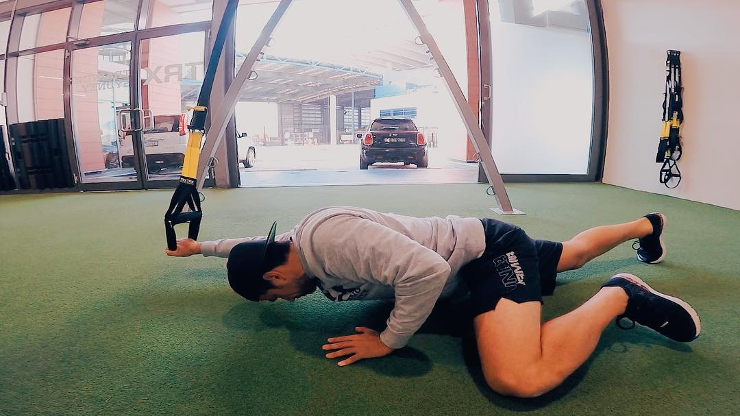 man performing exercise on TRX Suspension Trainer