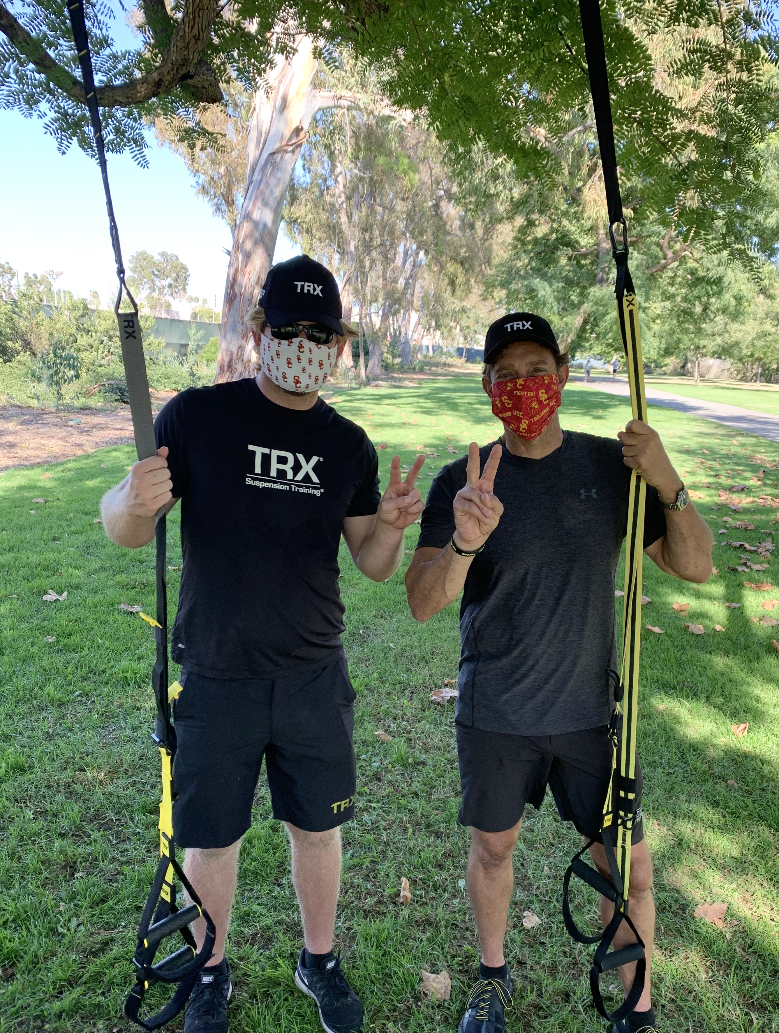 Jake Olson (left) and Randy Hetrick (right) pose with their Suspension Trainers after a TRX workout