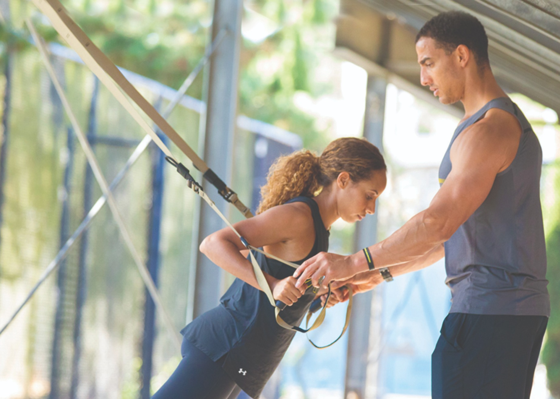 trainer working with client on TRX Suspension Trainer