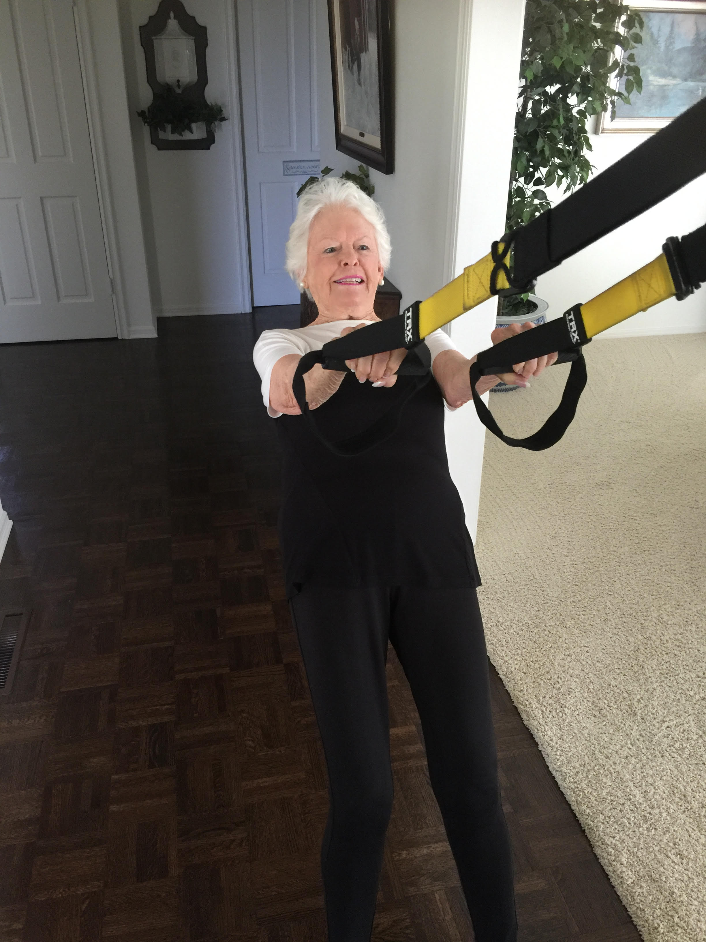 woman working out on TRX Suspension Trainer at home