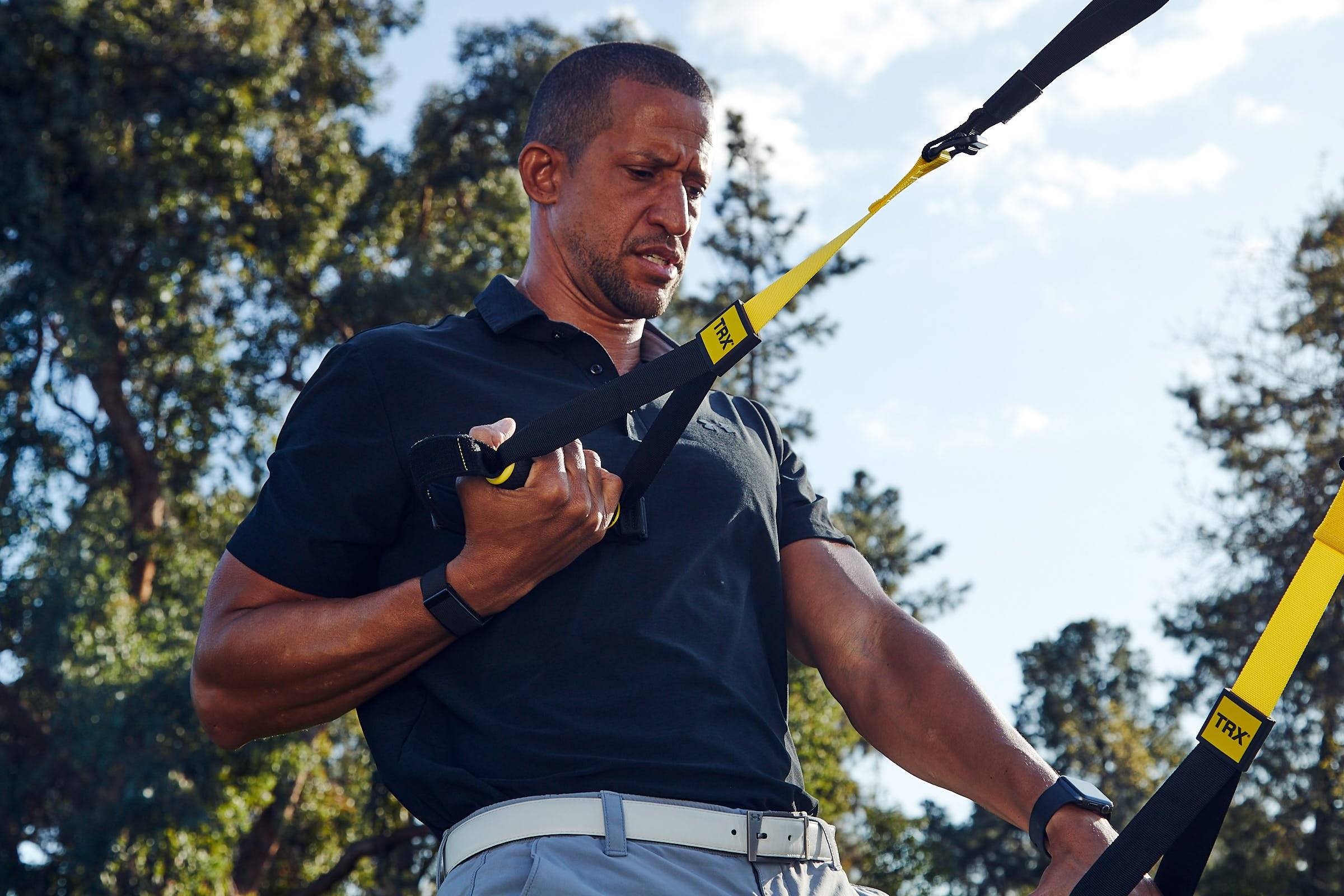 Trevor Anderson using a TRX Suspension Trainer to warm up for a golf game