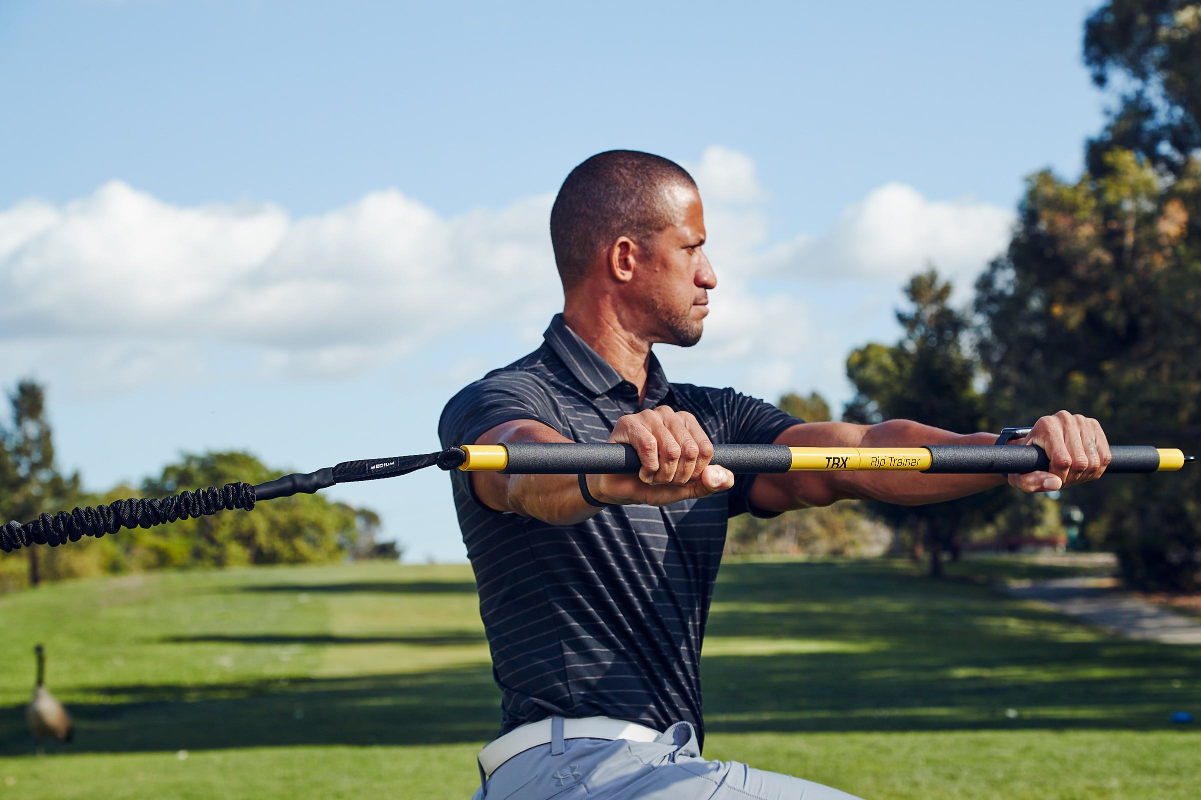 Trevor Anderson completing a TRX Rip Trainer step press lunge with rotation